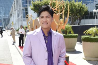 Johnny Ortiz on the red carpet at the 67th Emmy Awards.