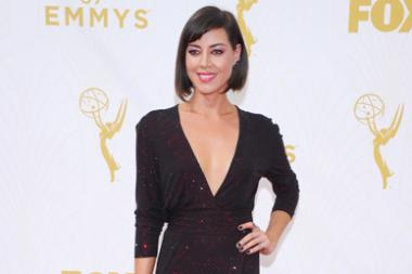 Aubrey Plaza on the red carpet at the 67th Emmy Awards.  `