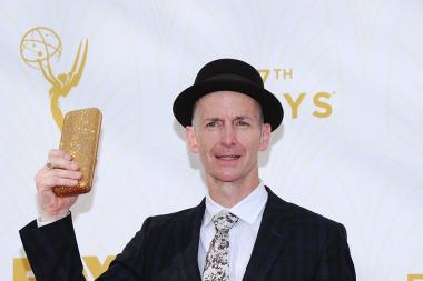 Dennis O'Hare on the red carpet at the 67th Emmy Awards.