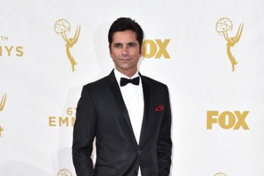 John Stamos on the red carpet at the 67th Emmy Awards.