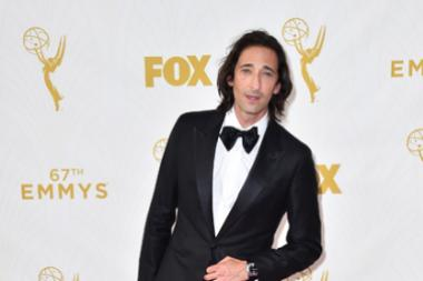 Adrien Brody on the red carpet at the 67th Emmy Awards.