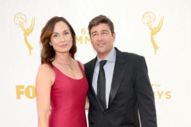 Kathryn Chandler and Kyle Chandler on the red carpet at the 67th Emmy Awards.