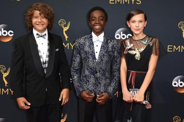 Gaten Matarazzo, Caleb McLaughlin and Millie Bobby Brown on the red carpet at the 2016 Primetime Emmys.