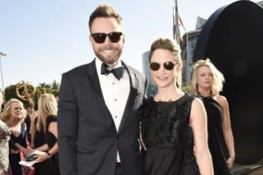 Joel McHale and Sarah Williams on the red carpet at the 2016 Primetime Emmys.