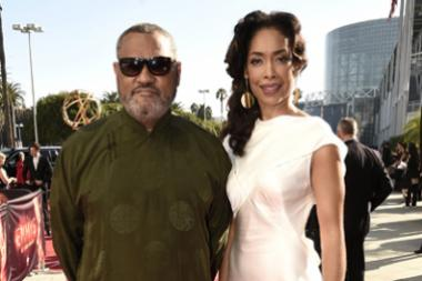 Laurence Fishburne and Gina Torres on the red carpet at the 2016 Primetime Emmys.