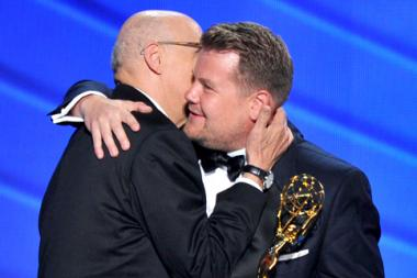 Jeffrey Tambor, left, accepts the award from James Corden at the 2016 Primetime Emmys.