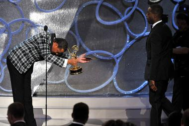 Terrence Howard, left, presents an award to Sterling K. Brown at the 2016 Primetime Emmys.