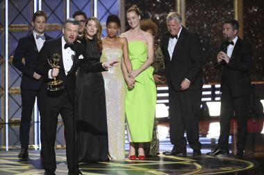 Charlie Brooker accepts her award at the 69th Primetime Emmy Awards