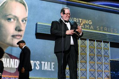 Bruce Miller accepts his award at the 69th Emmy Awards.