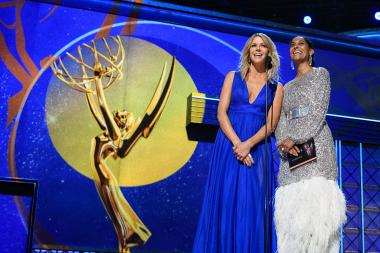Kaitlin Olson and Tracee Ellis Ross on stage at the 69th Emmy Awards.