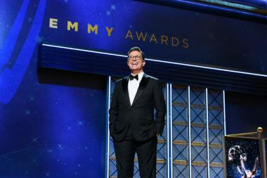 Stephen Colbert on stage at the 69th Emmy Awards.