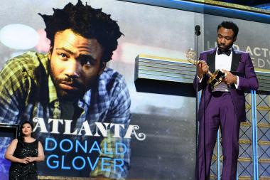 Donald Glover accepts an award at the 69th Emmy Awards.
