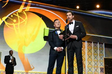BD Wong and Matt Bomer on stage at the 69th Emmy Awards.