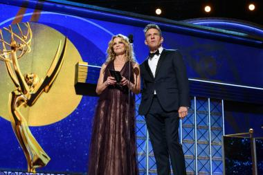 Kyra Sedgwick and Dennis Quaid on stage at the 69th Emmy Awards.