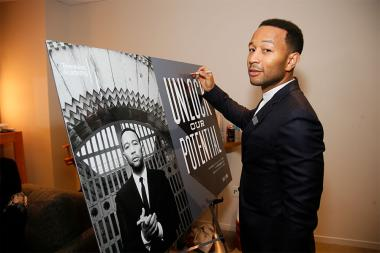 John Legend signs a poster at Unlock Our Potential at the Television Academy's Saban Media Center, August 9, 2016.