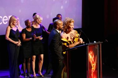 Khallid Shabazz and Frava Burgess accept an award at the 68th Los Angeles Area Emmys, July 23, 2016, at the Saban Media Center, North Hollywood, California.
