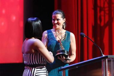 Neicy Nash presents an award to Lu Parker at the 68th Los Angeles Area Emmys, July 23, 2016, at the Saban Media Center, North Hollywood, California.