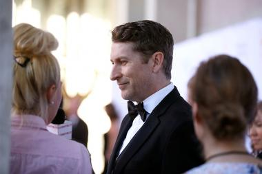 Host Scott Aukerman talks to the press at the 67th Los Angeles Area Emmy Awards July 25, 2015, at the Skirball Cultural Center in Los Angeles, California.