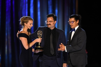 Vickie Curtis, Davis Coombe, and Jeff Orlowski accept an award at the 2021 Creative Arts Emmys.