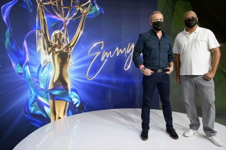 Safety first! Stewart and Hudlin model the Emmy-branded masks nominees will get this year.