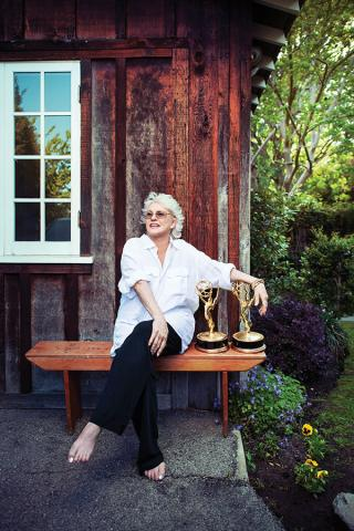 Sharon Gless outdoors with her two Emmys