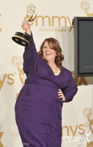 "Melissa McCarthy poses with the award for ""Outstanding Lead Actress in a Comedy Series"" in the press room"