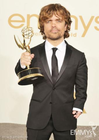 "Peter Dinklage poses with the award for ""Outstanding Supporting Actor in a Drama Series"" in the press room"