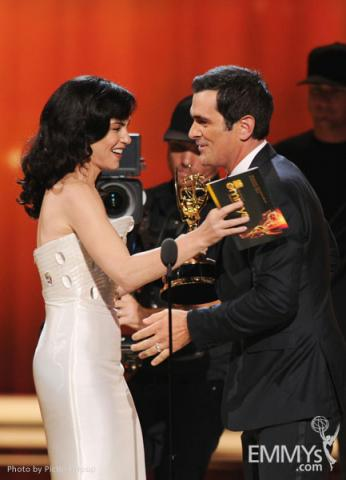 (L-R) Julianna Margulies presenting Ty Burrell with the award for Outstanding Supporting Actor in a Comedy Series