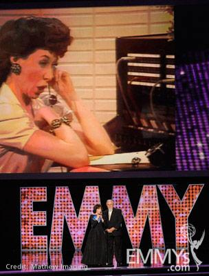 Lily Tomlin (L) and George Schlatter speak onstage during the 62nd Primetime Creative Arts Emmy Awards at Nokia Theatre