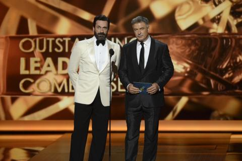 Jon Hamm and Alec Baldwin on stage at the 65th Emmys