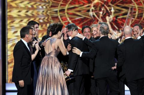 "The cast and crew of ""Breaking Bad"" on stage at the 65th Emmys"