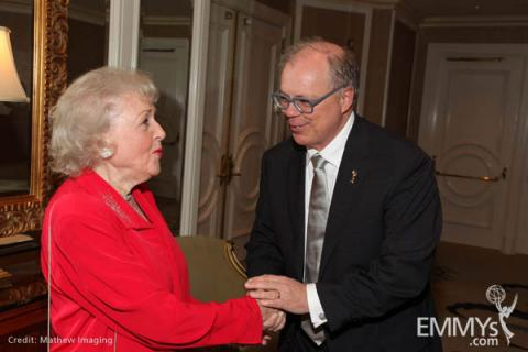Actress and Television Academy Hall of Fame member Betty White with the Academy's chairman and CEO, John Shaffner.