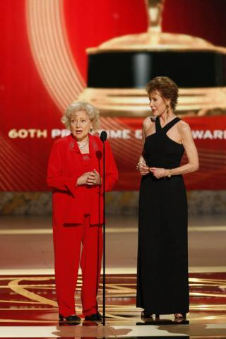 Betty White and Mary Tyler Moore presenting onstage at the 60th Primetime Emmy Awards