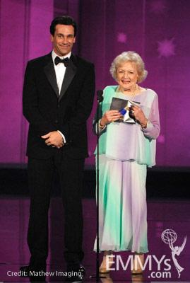 Actors Jon Hamm (L) and Betty White present an award onstage at the 62nd Annual Primetime Emmy Awards held at the Nokia Theatre