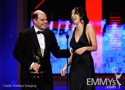 Writers Matthew Weiner (L) and Erin Levy speaks onstage at the 62nd Annual Primetime Emmy Awards held at the Nokia Theatre