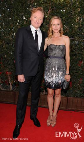 (L-R) Conan O'Brien and Liza Powel arrive at the Academy of Television Arts & Sciences 63rd Primetime Emmy Awards