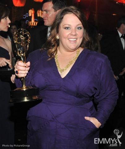 Melissa McCarthy poses with her award for Outstanding Lead Actress in a Comedy Series