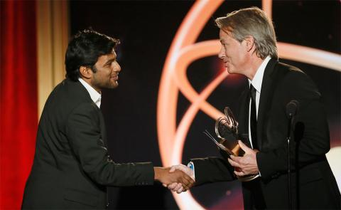 """Graham Yost presents Shubhashish Bhutiani, left, of School of Visual Arts with the Directing Award for """"Kush"""" at the 35th College Television Awards"""