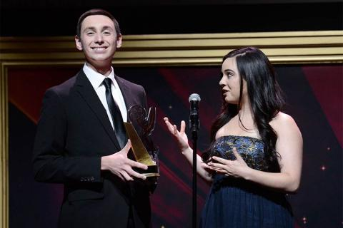 Christian Heilman and Rachel White accept an award at the 36th College Television Awards at the Skirball Cultural Center in Los Angeles, California, April 23, 2015.