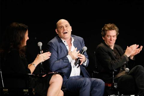 """Panel moderator Debra Birnbaum, Mad Men creator Matthew Weiner, and production designer Dan Bishop onstage at """"A Farewell to Mad Men,"""" May 17, 2015 at the Montalbán Theater in Hollywood, California."""