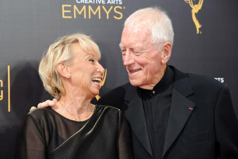 Catherine Brelet and Max von Sydow arrive on the red carpet at the 2016 Creative Arts Emmys.