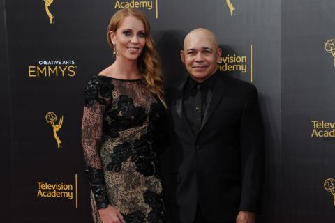 Eddie Perez and guest on the red carpet at the 2016 Creative Arts Emmys.