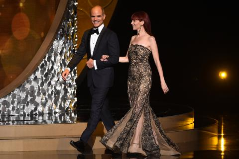 Michael Kelly and Carrie Preston on stage at the 2016 Creative Arts Emmys.