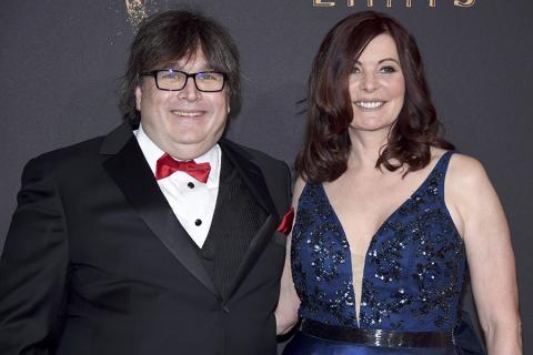Michael Bernard and guest on red carpet at the 2017 Creative Arts Emmys.