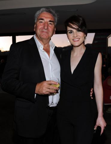 Jim Carter (l) and Michelle Dockery (r) of Downton Abbey attend the Performers nominee reception.