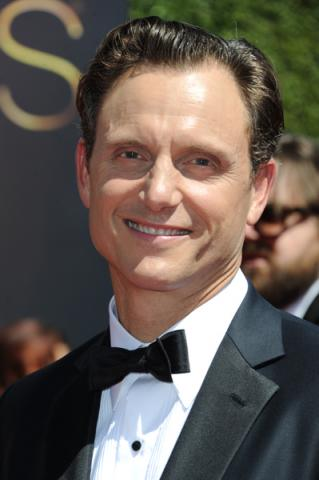 Tony Goldwyn arrives for the 2014 Primetime Creative Arts Emmys.