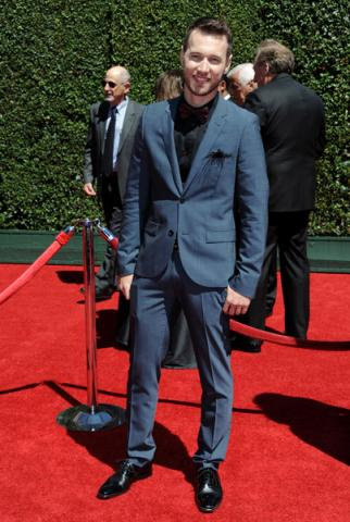 Christopher Scott arrives for the 2014 Primetime Creative Arts Emmys.