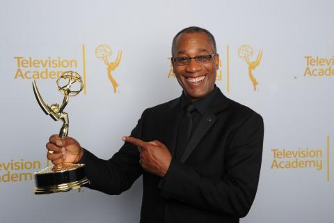 Joe Morton of Scandal celebrates at the 2014 Primetime Creative Arts Emmys.