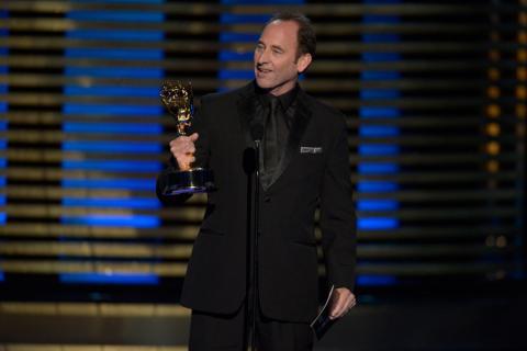 Editor Skip Macdonald of Breaking Bad accepts an award at the 2014 Primetime Creative Arts Emmys.