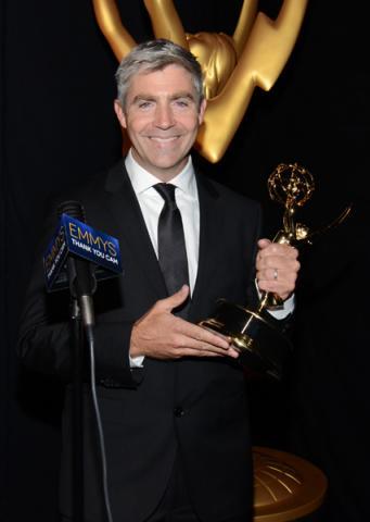 Adventure Time animator Nick Jennings celebrates his win at the 2014 Primetime Creative Arts Emmys.